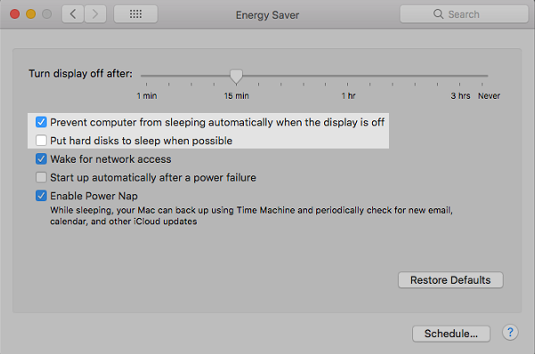 Prevent computer from sleeping automatically when the display is off and uncheck Put hard disks to sleep when possible